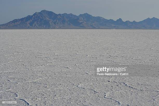Scenic View Of Landscape Against Mountains At Bonneville Salt Flats