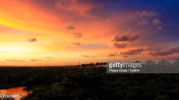 Scenic View Of Landscape Against Orange Sky