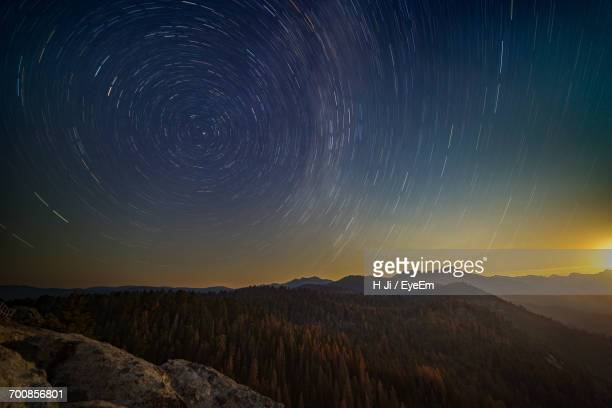 scenic view of landscape against sky at night - north star stock photos and pictures