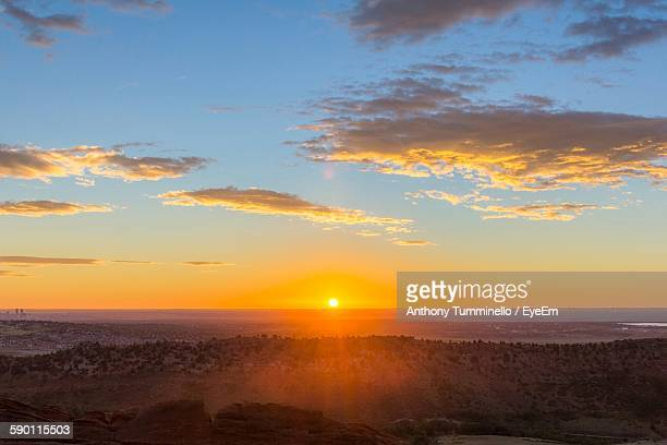 Scenic View Of Landscape Against Sky At Sunrise