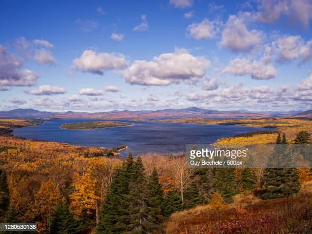 scenic view of landscape against sky during autumn, mooselookmeguntic lake, united states - mooselookmeguntic lake - fotografias e filmes do acervo