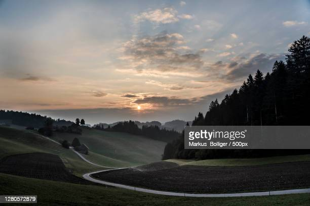 scenic view of landscape against sky during sunset,kaltacker,bern,switzerland - dämmerung stock pictures, royalty-free photos & images
