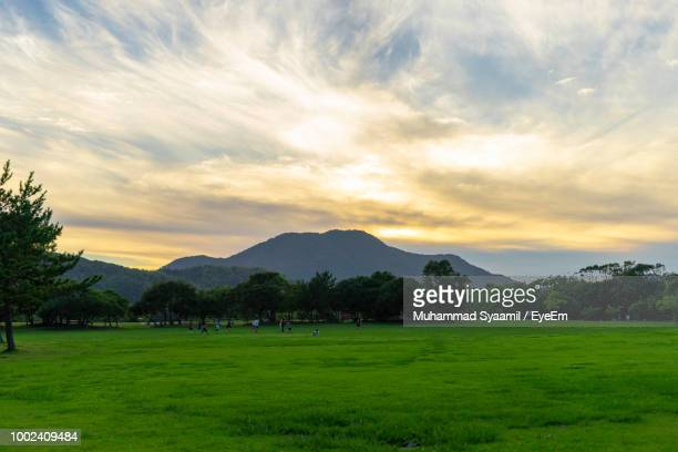 scenic view of landscape against sky during sunset - 福岡県 ストックフォトと画像