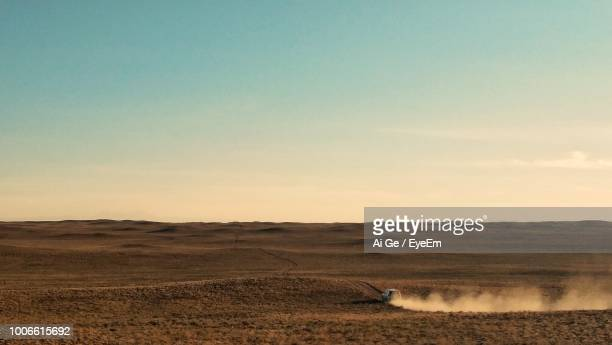 scenic view of landscape against sky during sunset - dust stock pictures, royalty-free photos & images