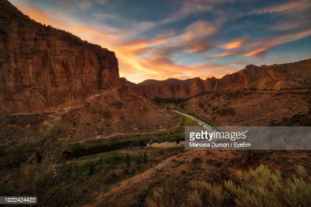 scenic view of landscape against sky during sunset - smith rock state park stock pictures, royalty-free photos & images