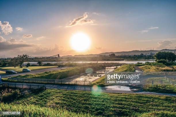 scenic view of landscape against sky during sunset - 富山県 ストックフォトと画像