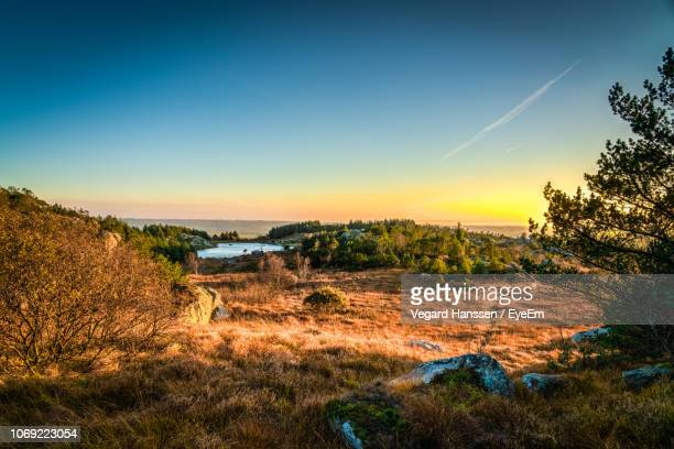 scenic view of landscape against sky during sunset - vegard hanssen stock pictures, royalty-free photos & images