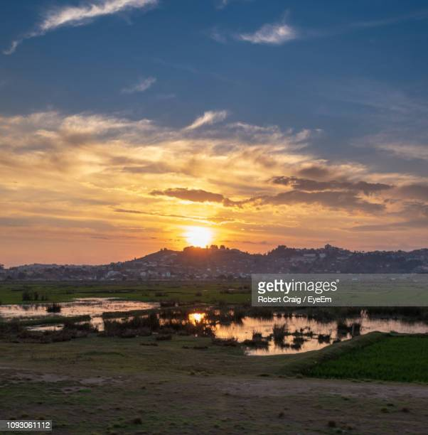 scenic view of landscape against sky during sunset - antananarivo stock photos and pictures