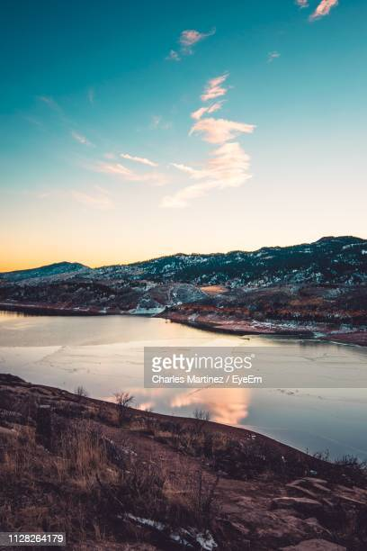 scenic view of landscape against sky during sunset - fort collins stock pictures, royalty-free photos & images