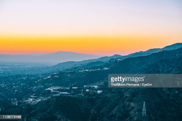 scenic view of landscape against sky during sunset - san fernando california stock photos and pictures
