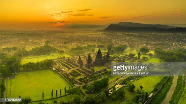 scenic view of landscape against sky during sunset - yogyakarta stock pictures, royalty-free photos & images