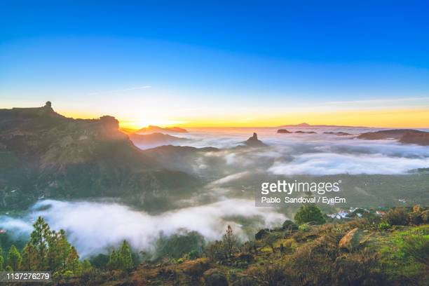 scenic view of landscape against sky during sunset - las palmas de gran canaria stock pictures, royalty-free photos & images