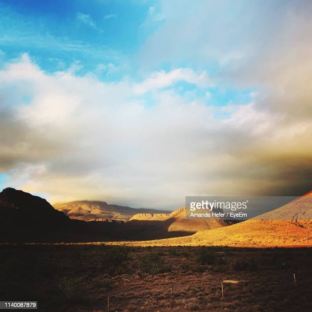 scenic view of landscape against sky during sunset - amanda and amanda stock pictures, royalty-free photos & images