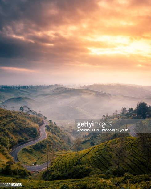 scenic view of landscape against sky during sunset - bandung stock pictures, royalty-free photos & images