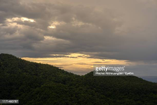 scenic view of landscape against sky during sunset - phichet ritthiruangdet stock photos and pictures