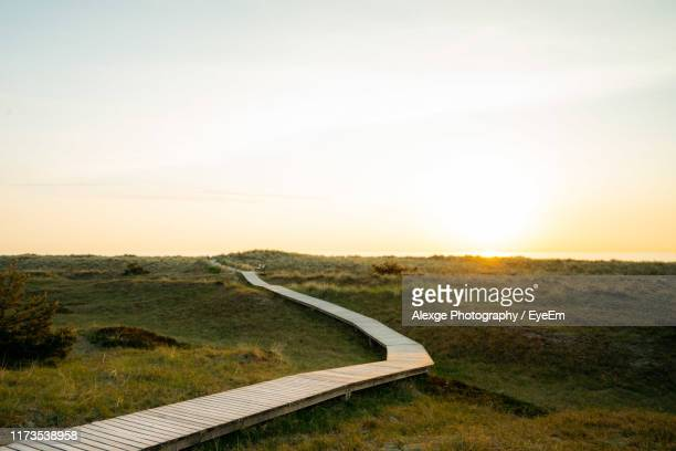 scenic view of landscape against sky during sunset - mecklenburg vorpommern stock pictures, royalty-free photos & images