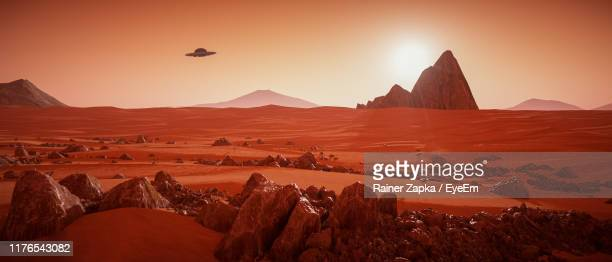 scenic view of landscape against sky during sunset - mars stock pictures, royalty-free photos & images