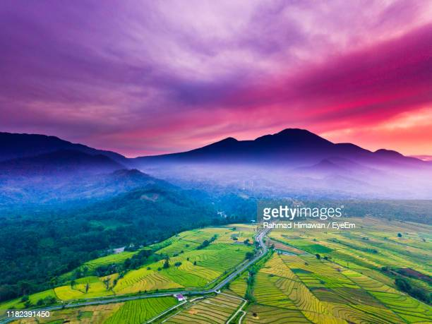 scenic view of landscape against sky during sunset - rahmad himawan stock photos and pictures