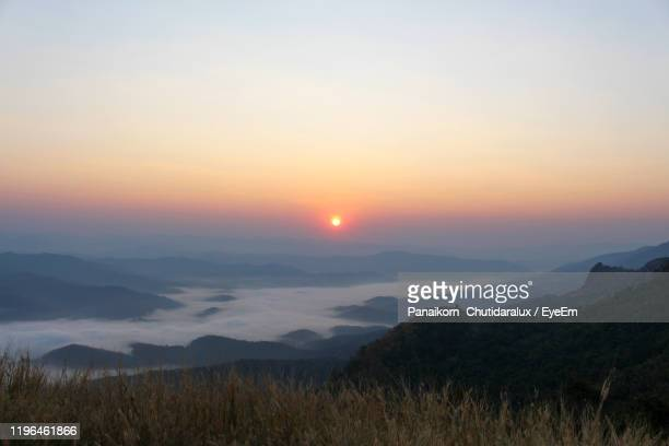 scenic view of landscape against sky during sunset - panaikorn chutidaralux stock photos and pictures