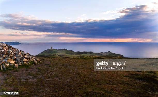scenic view of landscape against sky during sunset - isle of man stock pictures, royalty-free photos & images