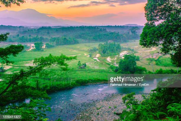 scenic view of landscape against sky during sunset - rahmad himawan stock pictures, royalty-free photos & images