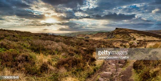 scenic view of landscape against sky during sunset - peak district national park stock pictures, royalty-free photos & images
