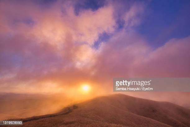 scenic view of landscape against sky during sunset - 熊本県 ストックフォトと画像