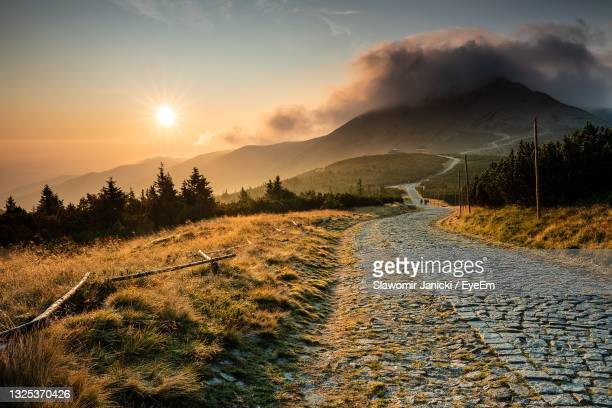 scenic view of landscape against sky during sunset - poland stock pictures, royalty-free photos & images