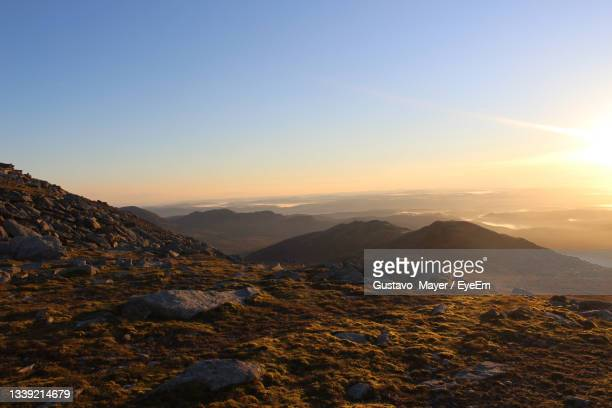 scenic view of landscape against sky during sunset - space and astronomy stock pictures, royalty-free photos & images