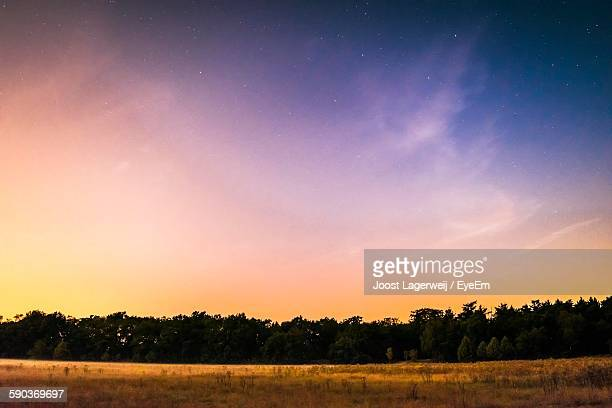 scenic view of landscape against sky during sunset - dusk stock pictures, royalty-free photos & images