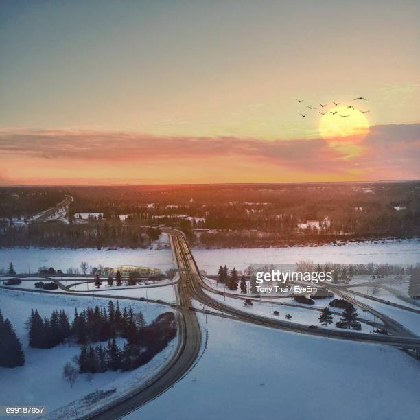 scenic view of landscape against sky during sunset - edmonton stock pictures, royalty-free photos & images
