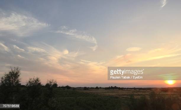 scenic view of landscape against sky during sunset - paulien tabak stock pictures, royalty-free photos & images