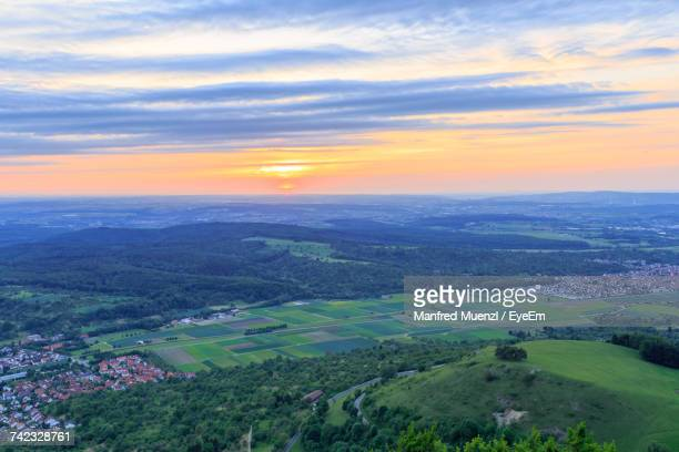 scenic view of landscape against sky during sunset - dämmerung stock-fotos und bilder