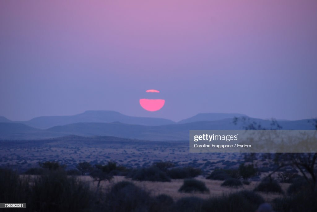 Scenic View Of Landscape Against Sky During Sunset : Foto stock