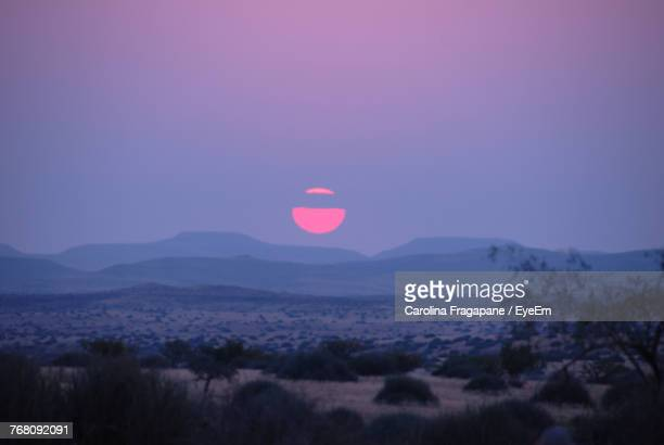 scenic view of landscape against sky during sunset - carolina fragapane stock pictures, royalty-free photos & images