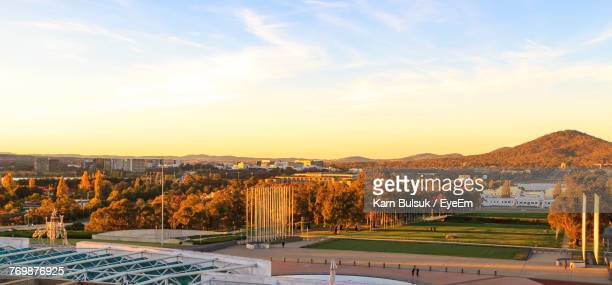 scenic view of landscape against sky during sunset - canberra stock pictures, royalty-free photos & images
