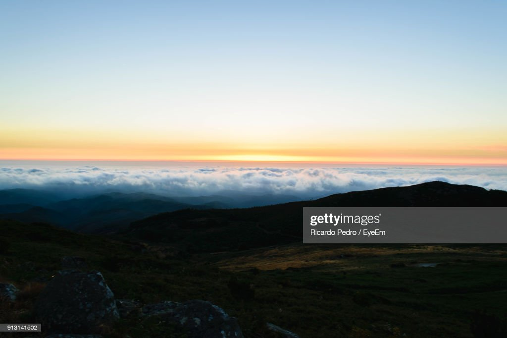 Scenic View Of Landscape Against Sky During Sunset : ストックフォト