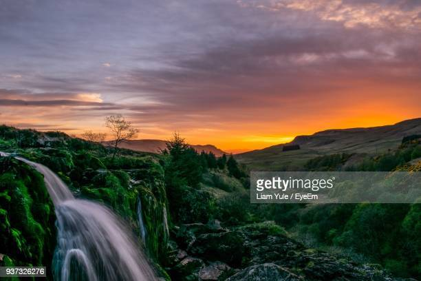 scenic view of landscape against sky during sunset - stirling stock pictures, royalty-free photos & images