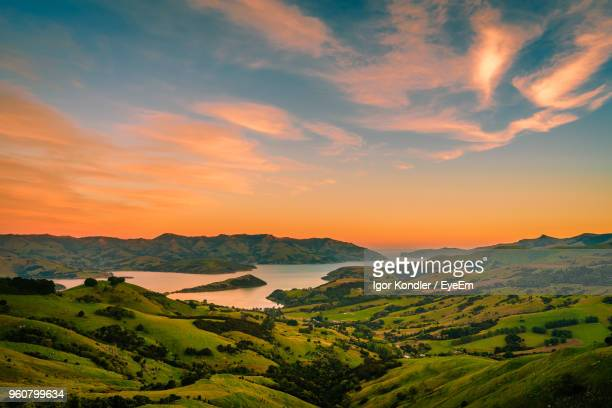 scenic view of landscape against sky during sunset - new zealand stock pictures, royalty-free photos & images
