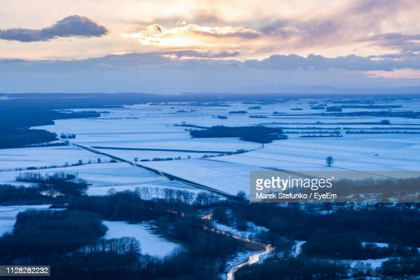 scenic view of landscape against sky during winter - marek stefunko stockfoto's en -beelden