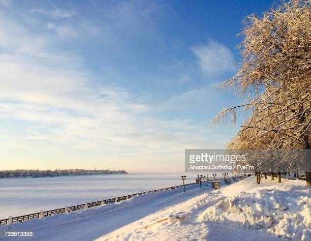 scenic view of landscape against sky during winter - anastasi foto e immagini stock