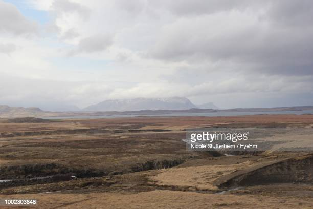 scenic view of landscape against sky - stutterheim stock photos and pictures