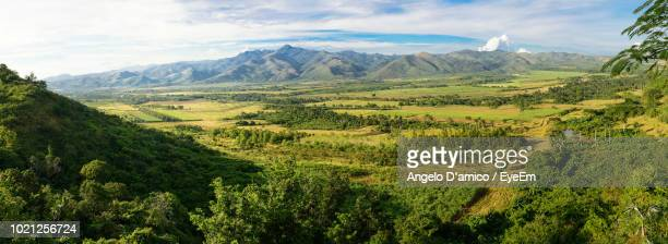 scenic view of landscape against sky - valley stock pictures, royalty-free photos & images