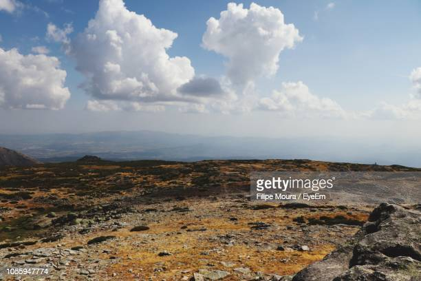 scenic view of landscape against sky - moura stock photos and pictures