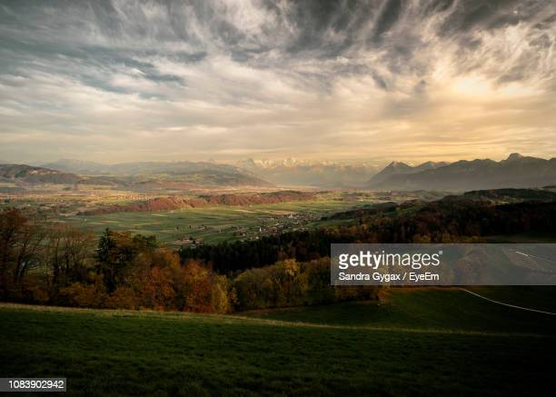 scenic view of landscape against sky - sandra gygax stock-fotos und bilder