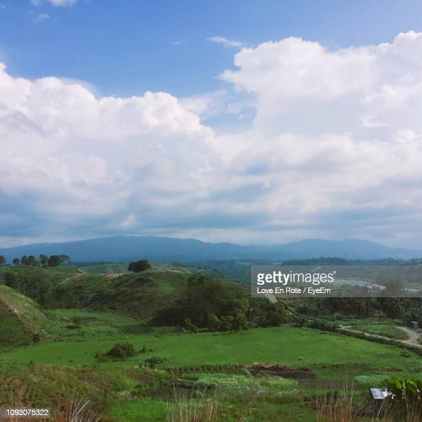 scenic view of landscape against sky - honiara stock pictures, royalty-free photos & images