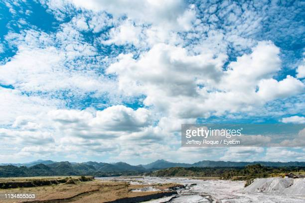 scenic view of landscape against sky - jeffrey roque stock photos and pictures