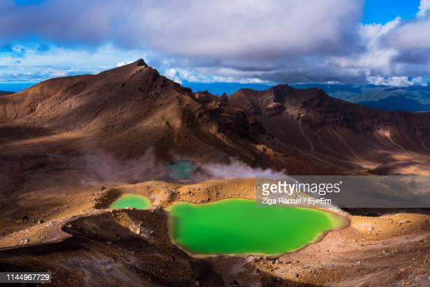 scenic view of landscape against sky - geology stock photos and pictures