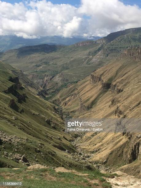 scenic view of landscape against sky - faina stock pictures, royalty-free photos & images