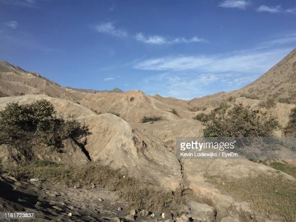 scenic view of landscape against sky - tengger stock pictures, royalty-free photos & images